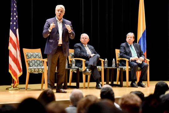 Colombian President Iván Duque Márquez, on left, met with Colombian Americans in New Jersey on Sunday in a town hall-style community forum hosted by Sen. Bob Menendez, center. The event was held at Elizabeth High School on September 22, 2019. Colombian Minister of Finance Mauricio Cárdenas Santamaría is pictured on right.