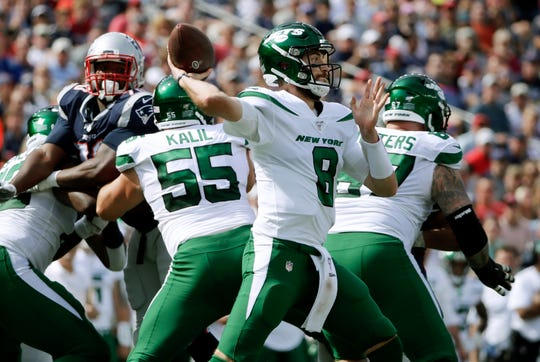 New York Jets quarterback Luke Falk passes against the New England Patriots in the first half of an NFL football game, Sunday, Sept. 22, 2019, in Foxborough, Mass. (AP Photo/Elise Amendola)