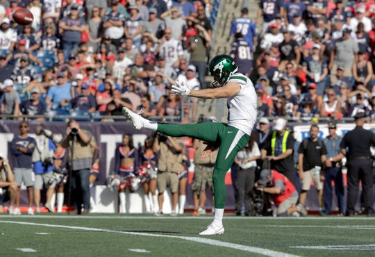New York Jets punter Lac Edwards follows through during a punt against the New England Patriots in the second half of an NFL football game, Sunday, Sept. 22, 2019, in Foxborough, Mass. (AP Photo/Steven Senne)