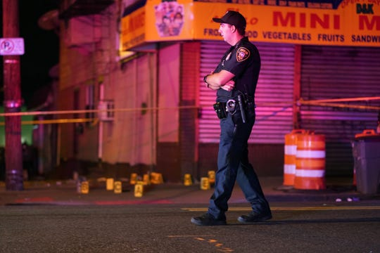 Police at the scene where three people were shot on 12th Avenue at E. 23rd Street in Paterson, NJ around 4 a.m. on September 22, 2019.