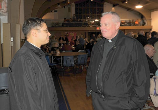 Monsignor Robert Harahan (right) with Father Roberto Ortiz in 2011 at St. Elizabeth School in Wyckoff.