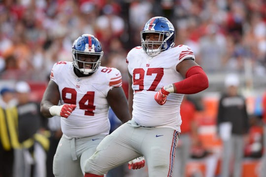 New York Giants defensive tackle Dexter Lawrence (97) celebrates a play against the Tampa Bay Buccaneers with defensive end Dalvin Tomlinson (94) during the second half of an NFL football game Sunday, Sept. 22, 2019, in Tampa, Fla. (AP Photo/Jason Behnken)
