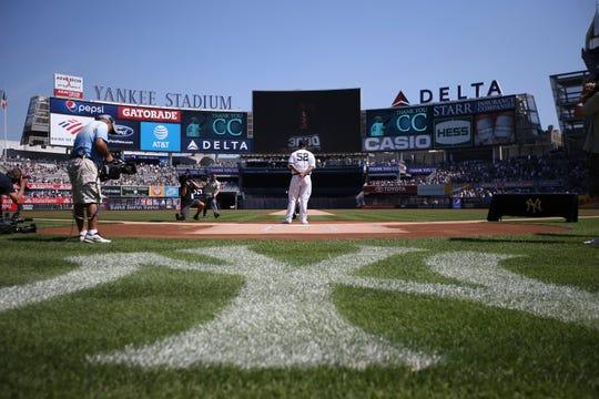 New York Yankees' CC Sabathia is honored before a baseball game against the Toronto Blue Jays of the team's baseball game, Sunday, Sept. 22, 2019, in New York. (AP Photo/Michael Owens)