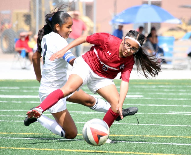 Freshman Lady 'Cat Gabriela Chavez (cardinal jersey) scored two second-half goals in a span of seven minutes to help the Deming High varsity defeat visiting Gadsden High on Saturday, 3-0.