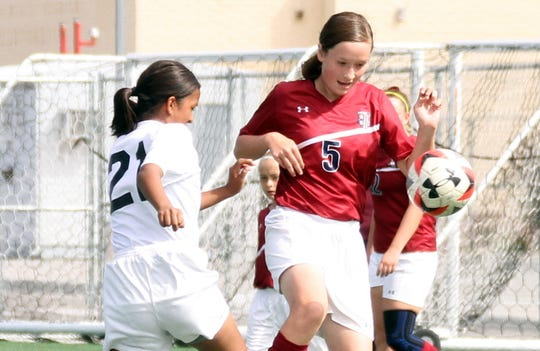 Freshman Lady 'Cat Santana Valentine (5) kept pressure on the visiting Panthers on Saturday and scored a goal.