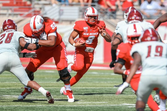 UNM sophomore quarterback Tevaka Tuioti (8) runs the ball in the first half during a game against New Mexico State University at Dreamstyle Stadium in Albuquerque on Saturday, Sept. 21, 2019.