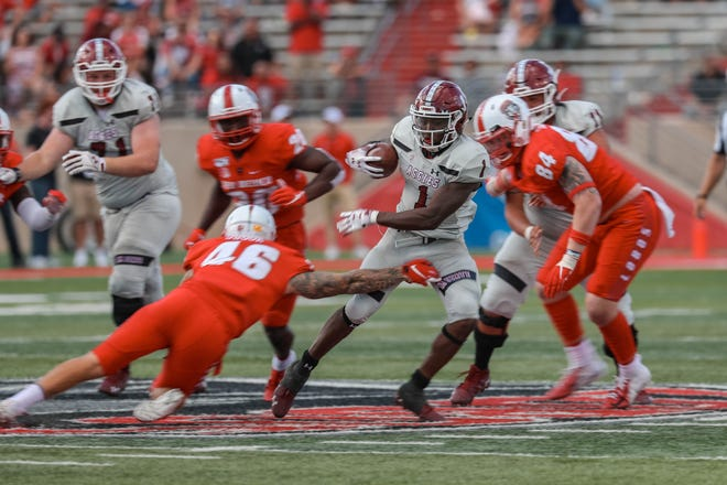 NMSU senior running back Jason Huntley (1)  runs the ball in the second half during a game against University of New Mexico at Dreamstyle Stadium in Albuquerque on Saturday, Sept. 21, 2019.