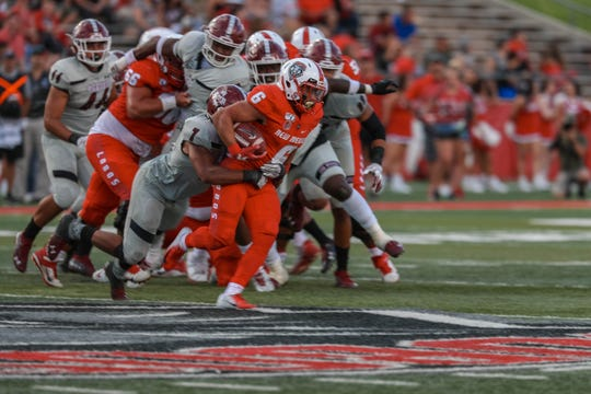 UNM sophomore running back Bryson Carroll (6) runs the ball in the second half during a game against New Mexico State University at Dreamstyle Stadium in Albuquerque on Saturday, Sept. 21, 2019.