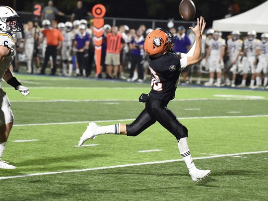 Brother Rice sophomore wide receiver catches a 41-yard pass from Greg Piscopink in the fourth quarter. Brother Rice earns a 16-14 win against De La Salle on Sept. 21.