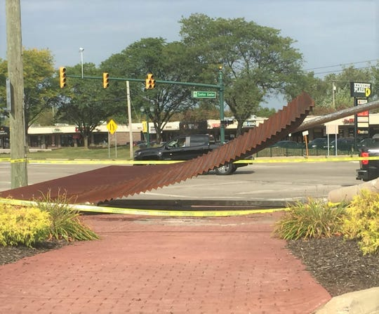 The sculpture located near the intersection of Canton Center and Ford roads was toppled in a two-car crash Sunday morning.