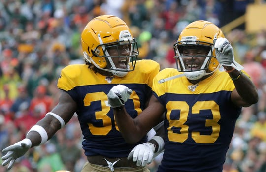 Green Bay Packers receiver Marquez Valdes-Scantling (83) celebrates with running back Jamaal  Williams (30) following a touchdown catch in the first quarter against the Denver Broncos during their football game Sunday, September 22, 2019, at Lambeau Field in Green Bay, Wis. Wm. Glasheen/USA TODAY NETWORK-Wisconsin