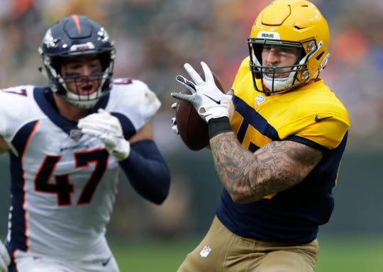 Green Bay Packers fullback Danny Vitale (45) pulls down a reception agianst Denver Broncos inside linebacker Josey Jewell (47) in the third quarter Sunday, September 22, 2019, at Lambeau Field in Green Bay, Wis.