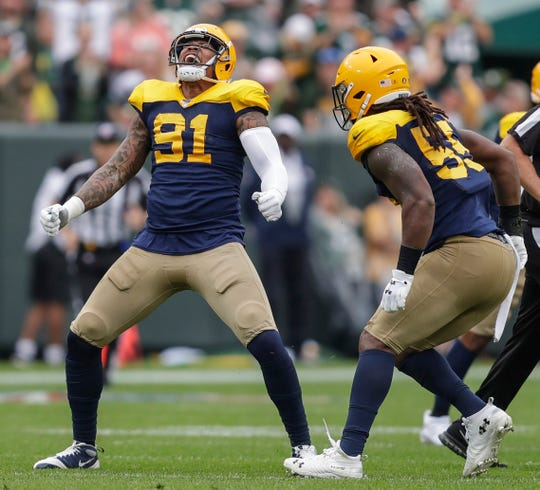 Green Bay Packers outside linebacker Preston Smith (91) reacts after sacking Denver Broncos quarterback Joe Flacco (5) during their football game Sunday, September 22, 2019, at Lambeau Field in Green Bay, Wis.Joshua Clark/USA TODAY NETWORK-Wis.