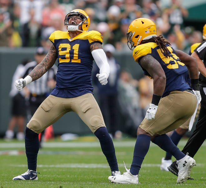 Green Bay Packers outside linebacker Preston Smith (91) reacts after sacking Denver Broncos quarterback Joe Flacco (5) during their football game Sunday, September 22, 2019, at Lambeau Field in Green Bay, Wis.