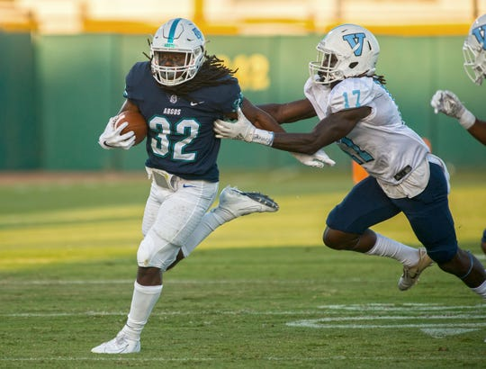 West Florida's Anthony Johnson Jr. runs down field Saturday, September 21, 2019 during first half action against Virginia-Lynchburg at Blue Wahoos Stadium.