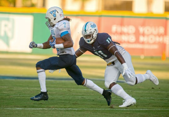 Virginia-Lynchburg's Tomas Newman is chased by West Florida's Chanler Ferguson Saturday, September 21, 2019 during first half action against Virginia-Lynchburg at Blue Wahoos Stadium.