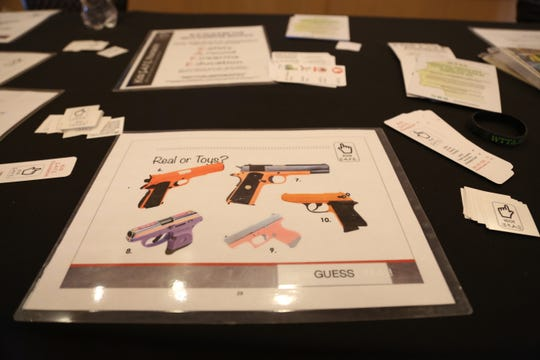 An information sheet prompting children to discern between real and toy guns is displayed at the Kids S.A.F.E. Foundation's booth at this year's conference. The organization aims to educate children on firearm safety, with a goal of achieving zero firearm accidents.