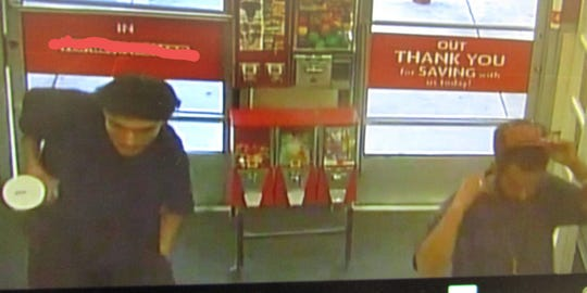 Two unidentified men are suspected of stealing laundry detergent.
