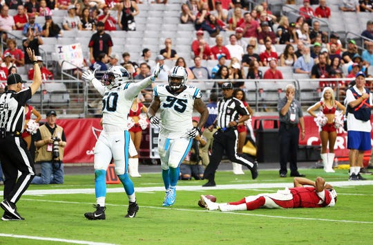 Carolina Panthers linebacker Christian Miller (50) reacts after sacking Arizona Cardinals quarterback Kyler Murray (right, on ground) late in the fourth quarter during a game on Sep. 22, 2019 in Glendale, Ariz.