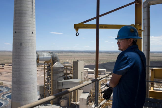 Jarvison Littlesunday looks over the plant from the 177-foot level during his daily inspection on July 5, 2019, at the Coronado Generating Station near St. Johns, Arizona.