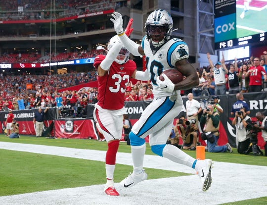 Carolina Panthers wide receiver Curtis Samuel (10) catches a touchdown pass while defended by Arizona Cardinals cornerback Byron Murphy (33) during the second quarter at State Farm Stadium September 22, 2019.
