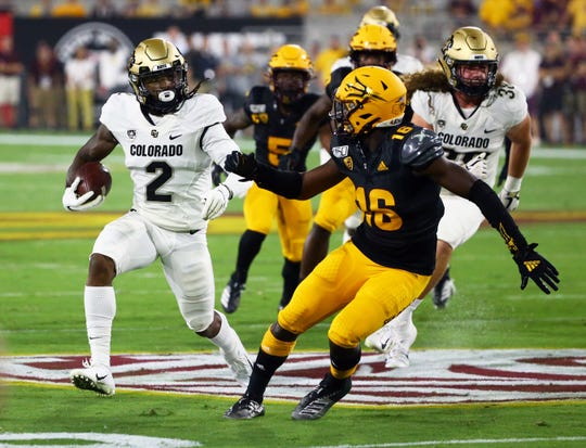 Colorado Buffaloes wide receiver Laviska Shenault Jr. (2) runs with the ball against Arizona State Sun Devils safety Aashari Crosswell (16)in the first half during a game on Sep. 21, 2019 in Tempe, Ariz.