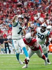 Carolina Panthers quarterback Kyle Allen (7) throws a touchdown while pursued by Arizona Cardinals outside linebacker Terrell Suggs (56) during the second quarter at State Farm Stadium September 22, 2019.