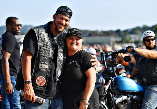 Big Mike Taylor, of the Infamous Ryders, and his wife LoLo of the Street Queenz, prior to the 25th Annual York Bike Night bike parade in York, Saturday, Sept. 21, 2019. Dawn J. Sagert photo