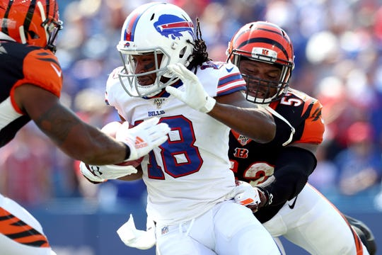 ORCHARD PARK, NEW YORK - SEPTEMBER 22: Andre Roberts #18 of the Buffalo Bills runs the ball as Preston Brown #52 of the Cincinnati Bengals attempts to tackle him during a game at New Era Field on September 22, 2019 in Orchard Park, New York. (Photo by Bryan M. Bennett/Getty Images)