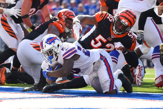 Sep 22, 2019; Orchard Park, NY, USA; Buffalo Bills running back Frank Gore (20) runs into the end zone past Cincinnati Bengals middle linebacker Preston Brown (52) for a touchdown during the fourth quarter at New Era Field. Mandatory Credit: Rich Barnes-USA TODAY Sports