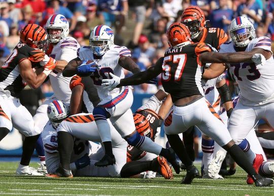 Bills running back Frank Gore bursts through the line of scrimmage.