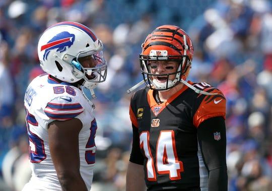 Jerry Hughes of the Bills meets with Bengals quarterback Andy Dalton before kickoff at New Era Field.