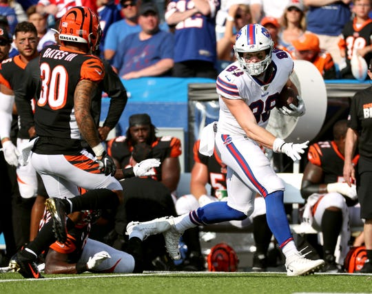 Bills rookie tight end Dawson Knox fights for extra yards after a catch to help put the Bills inspiring position against the Bengals.