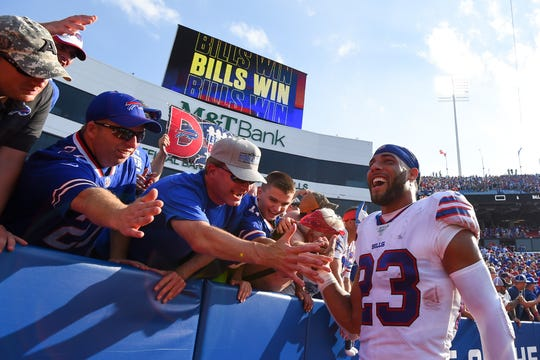 Sep 22, 2019; Orchard Park, NY, USA; Buffalo Bills strong safety Micah Hyde (23) celebrates with fans following the game against the Cincinnati Bengals at New Era Field. Mandatory Credit: Rich Barnes-USA TODAY Sports