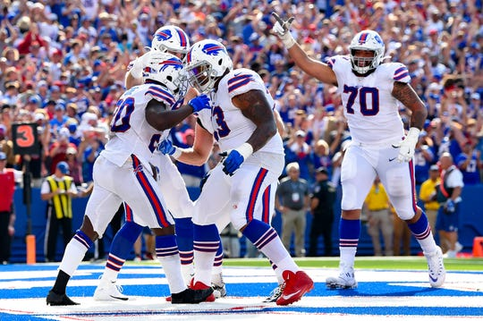 Sep 22, 2019; Orchard Park, NY, USA; Buffalo Bills running back Frank Gore (20) celebrates is touchdown run with teammates against the Cincinnati Bengals during the fourth quarter at New Era Field. Mandatory Credit: Rich Barnes-USA TODAY Sports
