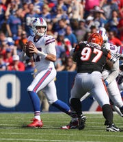 Bills quarterback Josh Allen drops back to pass.