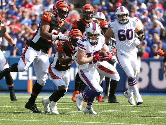 Bills receiver Cole Beasley looks for extra yards against the Bengals.
