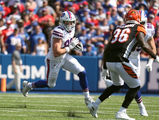 Bills rookie tight end Dawson Knox looks for yards after a catch.