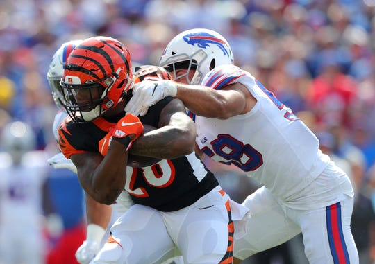 ORCHARD PARK, NY - SEPTEMBER 22:  Joe Mixon #28 of the Cincinnati Bengals runs the ball and gets tackled by Matt Milano #58 of the Buffalo Bills during the first quarter at New Era Field on September 22, 2019 in Orchard Park, New York.  (Photo by Timothy Ludwig/Getty Images)