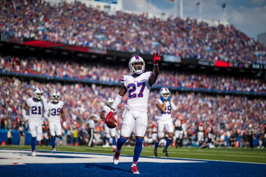 Tre'Davious White celebrates his game-clinching interception in the final seconds of Buffalo's game against Cincinnati in Orchard Park, New York, on Sunday.