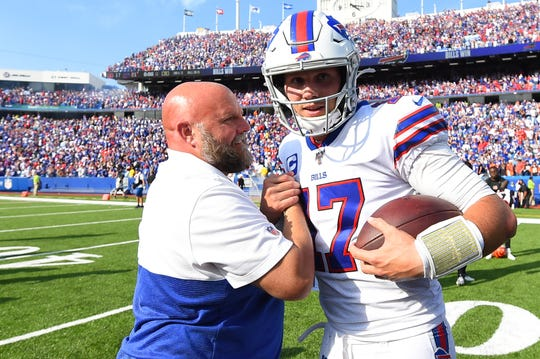 Buffalo Bills quarterback Josh Allen greets offensive coordinator Brian Daboll following the game against the Cincinnati Bengals at New Era Field.