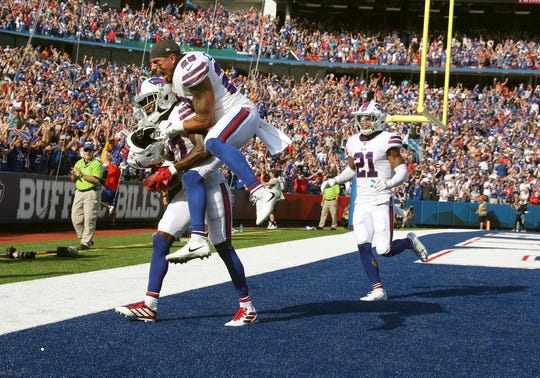 Bills Kurt Coleman jumps on the back of Tre'Davious White after his second interception of the game stopped a potential go ahead score by the Bengals.