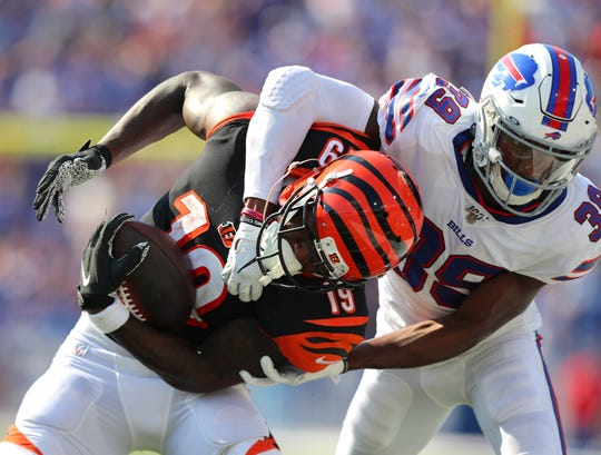 Levi Wallace (39) of the Buffalo Bills tackles Auden Tate (19) of the Cincinnati Bengals after making a catch during the second half at New Era Field on September 22, 2019 in Orchard Park, New York.