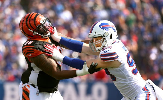 Bills Trent Murphy tries to beat the block by Bengals Bobby Hart.