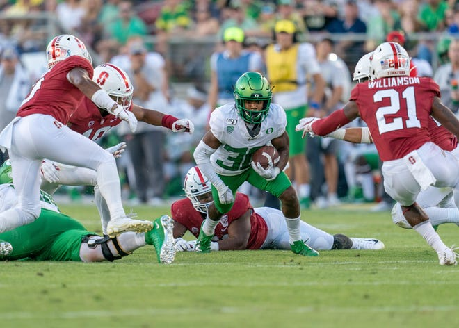 Sep 21, 2019; Stanford, CA, USA; Oregon Ducks wide receiver Jaylon Redd (30) is tackled by Stanford Cardinal linebacker Jordan Fox (10) during the fourth quarter at Stanford Stadium. Mandatory Credit: Neville E. Guard-USA TODAY Sports