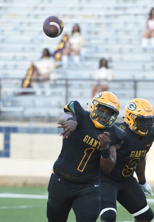 Green Oaks quarterback Keith Baker tallied five touchdowns (four passing, one rushing) in Saturday's Soul Bowl victory over BTW.