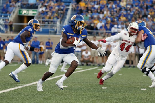 South Dakota State's Pierre Strong Jr (20) sprints to the outside for big yards during the second quarter of the Jackrabbits' matchup against the Thunderbirds Saturday night at Dana J. Dykhouse Stadium in Brookings.