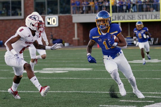 South Dakota State's Cade Johnson (15) sprints to the sideline after a catch against Southern Utah's Carlton Johnson during the first quarter of the Jackrabbits' matchup against the Thunderbirds Saturday night at Dana J. Dykhouse Stadium in Brookings.