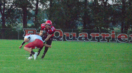 St. Mary running back Payton Park rushes against Avon on Friday, Sept. 20 as the Cardinals played at the Dell Rapids public high school due to flooding issues in Dells.