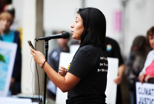 Amy Ramirez discusses her support for the Green New Deal during a climate strike at Park Central Square in Springfield Sunday, Sept. 22, 2019.